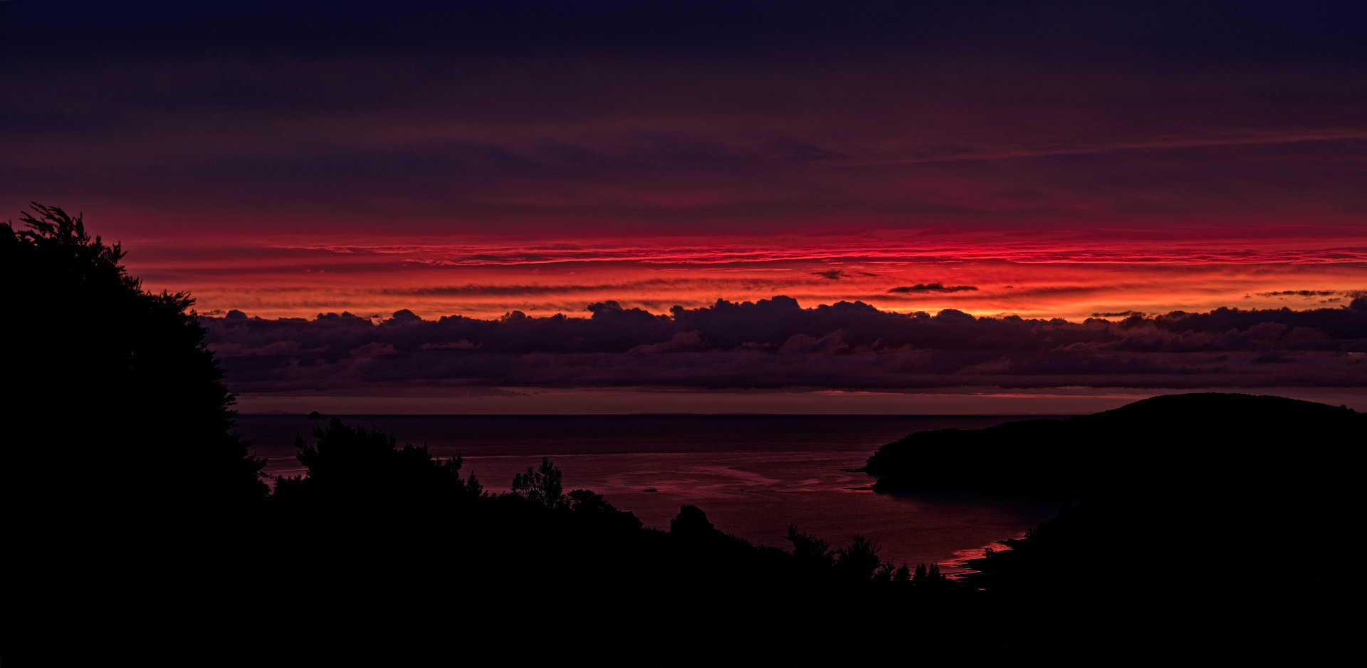 A very colourful sunset. Great-Barrier-Island-New-Zealand-Nov.17-20.05-f16-1/160s-iso800-100mm-300dpi-max.-res.-14576x7121-px
